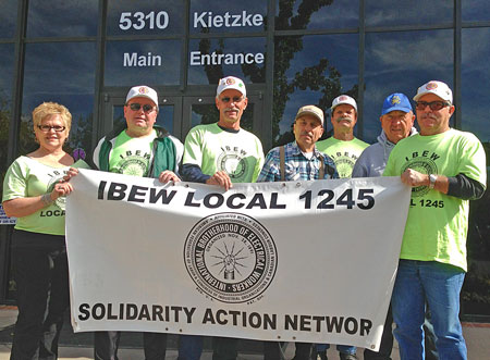 Members of the Reno/Sparks Chapter of the IBEW 1245 Retirees Club protest at the Reno office of U.S. Representative Mark Amodei on Oct. 16.