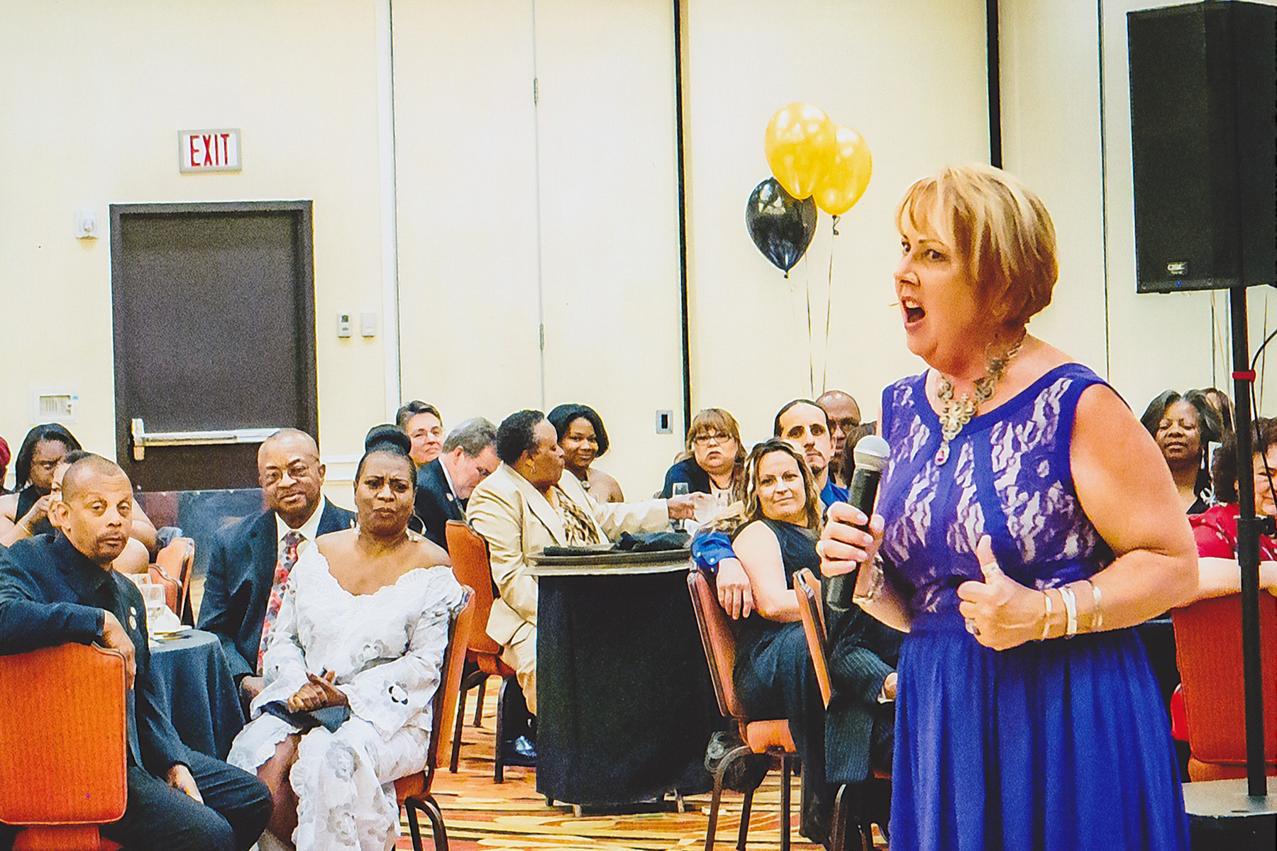 """Debbie belts out """"I Did It My Way"""" at Dorothy Fortier's retirement party."""