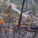 """IBEW 1245 members from PG&E replace poles in steep terrain after being destroyed by the ""Rocky Fire"" in Clearlake, Calif., on August 6th, 2015."""