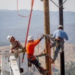 "The crew works together to replace poles in steep terrain after being destroyed by the ""Rocky Fire"""