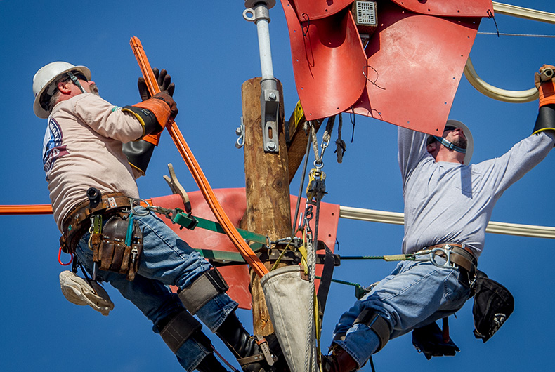 PG&E Linemen Jim Moon, left, and Rob Mitchell at the PG&E-IBEW 1245 Lineman Rodeo in Livermore, Calif., on August 1st, 2015.