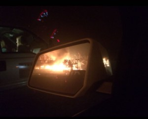 Jessica Smith captured this photo in her rear-view mirror as her house burned down in front of her eyes.