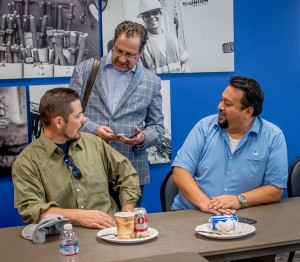 Gas Service Reps Robert Mohler (left) and Mike Adayan (right) chat with Nick Stavropoulos (center)