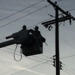 A PG&E crew gets ready to close a cutout