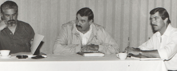 Bob Choate, middle, on a PG&E bargaining committee in the early 1980s. At right is committee member Larry Pierce, who was hired onto the Local 1245 staff about the same time as Choate.