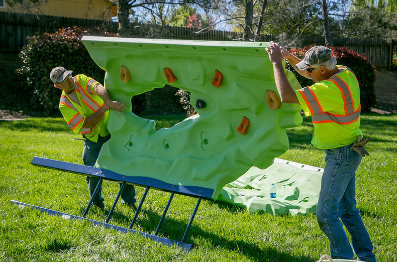 IBEW members Mike Herzog, left, and Rahman Mansfield put together a playground for the City of Redding parks Department in Redding, Calif., on March 29th, 2016.