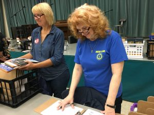 1245 retiree Rita Weisshaar( right) checking in volunteers