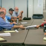PG&E's Robert Joga hands IBEW 1245 Business Manager Tom Dalzell a copy of the Company's proposal