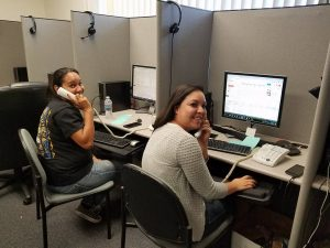 Alicia Cordero and Aileen Zuehlke phone-banking for union-endorsed candidates
