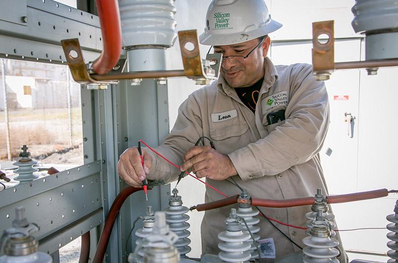 IBEW member Leon Alcantar checks capacitors at a Silicon Valley Power substation in Santa Clara, Calif., on March 15th, 2016.