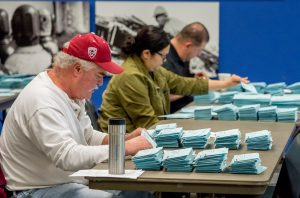 Members of the Ballot Committee sort and count votes at Weakley Hall on Dec. 13, 2016