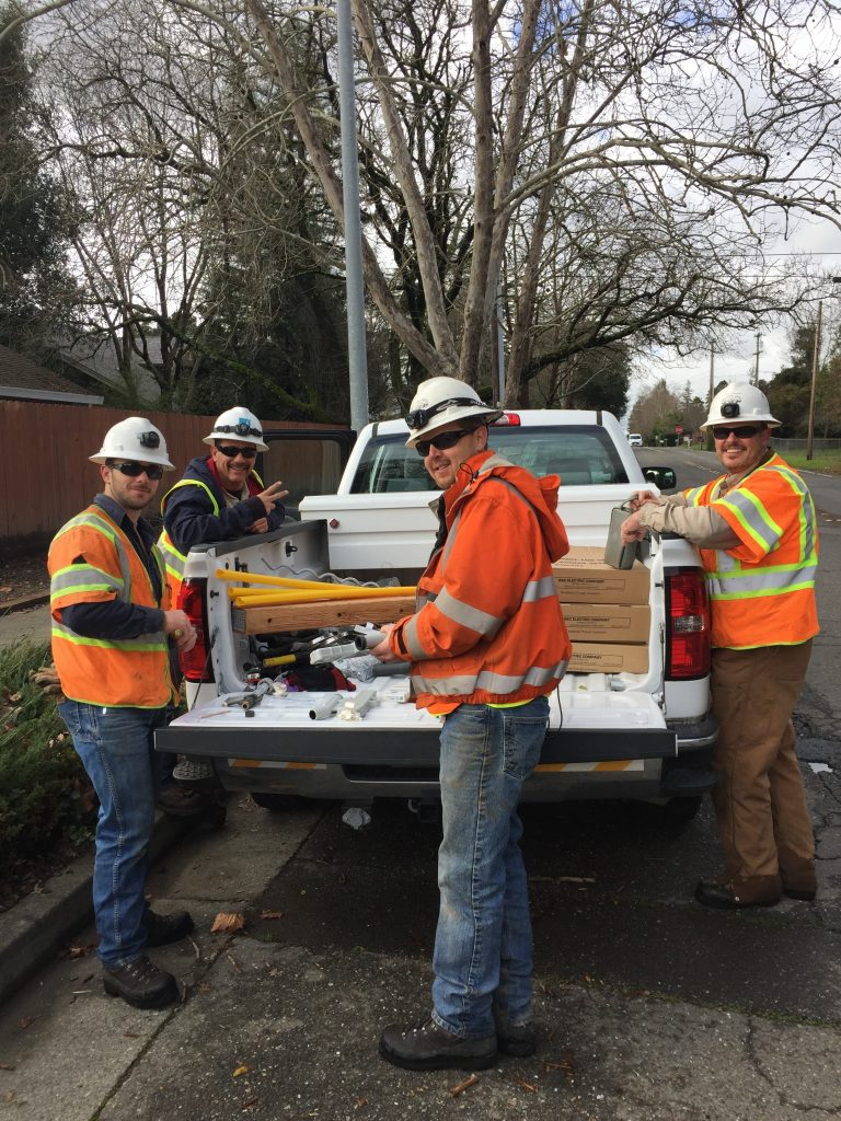 Pictured from left: Healdsburg Apprentice Lineman Chayton Osmon, PG&E Lineman Victor Torino out of Santa Rosa, Healdsburg Electric Crew Foreman Mike Courts and Healdsburg Lineman Jason Hageman working together to replace blown fault famer fuses