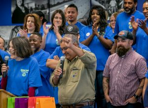 STESEC spokesperson Fredy Lopez raised his fist in solidarity as he addressed the Local 1245 leaders and members