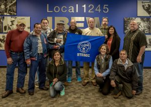 The STESEC delegation and Local 1245 staffers with Business Manager Tom Dalzell