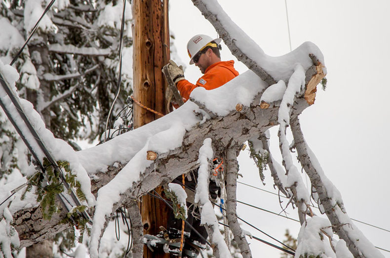An IBEW 1245 crew from Par Electric fixes a broken cross arm caused by a snow storm in Tahoe Vista, Calif. on January 13th, 2017.