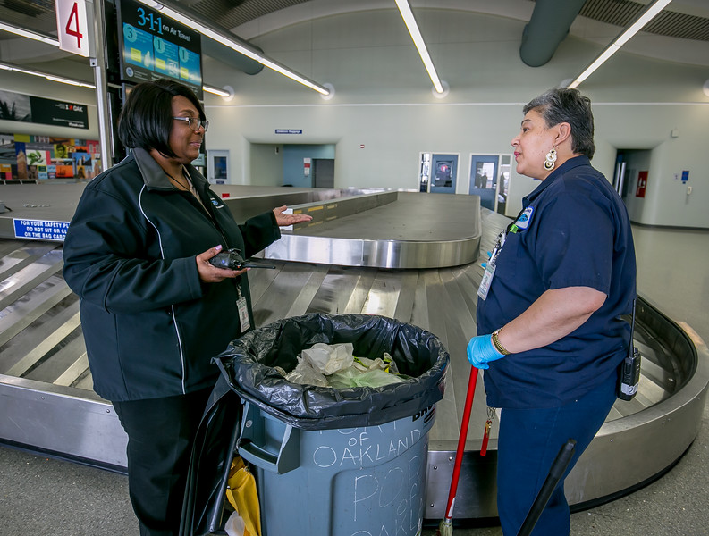 IBEW 1245 member Jayzelle Norflin (left)  with janitor Elsie Valentin-Miguel at the Oakland Airport