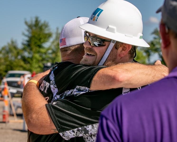 a congratulatory hug for team Quiet Riot