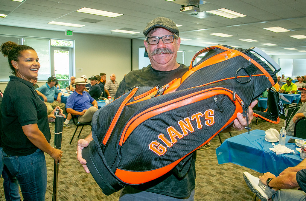 A few golfers won high end golf bags in the raffle