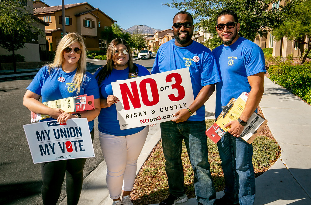 IBEW 1245 members; left to right: Jerico Jimenez, Brittney Santana, Teofilo Freeman, and Tracey Amaro walk a neighborhood for the No on 3 Campaign in Las Vegas, Nevada  on October 17th, 2018.