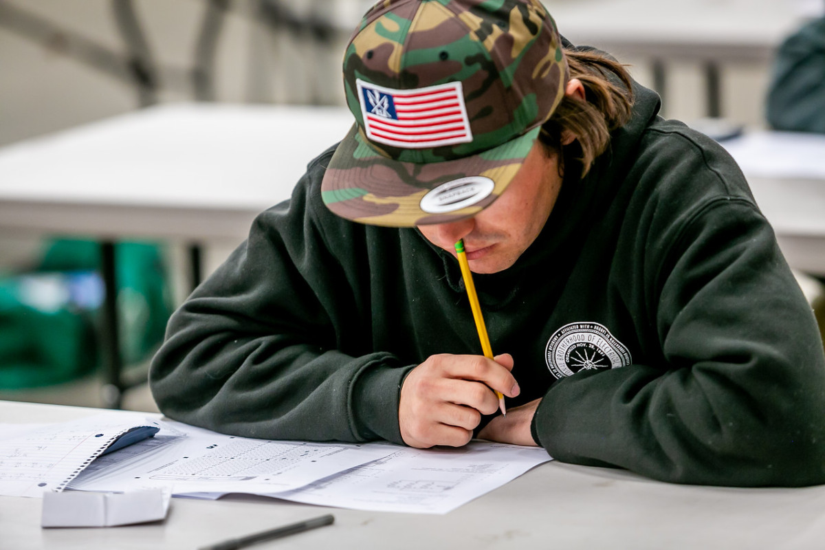 An apprentice lineman takes a written test to verify he's obtained the knowledge he needs to advance through the program.